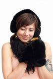 Mujer en manopla caliente negra Foto de archivo