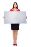 Mujer en muestra que muestra roja Imagen de archivo