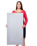 Mujer en muestra que muestra roja Imagen de archivo libre de regalías