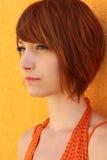 Mujer en naranja Imagenes de archivo