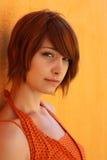 Mujer en naranja Fotos de archivo libres de regalías