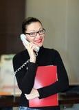 Mujer en oficina Fotos de archivo