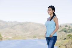 Mujer en paisaje Foto de archivo libre de regalías
