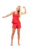 Mujer en pijamas rojos Fotos de archivo libres de regalías