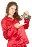 Mujer en pijamas rojos con café Fotografía de archivo libre de regalías