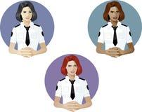 Mujer en referente del uniforme de la policía Imagen de archivo libre de regalías