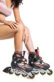 Mujer en rodillos Imagen de archivo libre de regalías