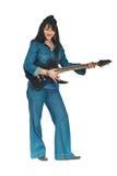 Mujer en ropa del dril de algodón con la guitarra Fotos de archivo