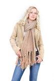 Mujer en ropa del invierno sobre blanco Imagenes de archivo