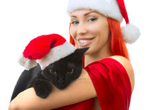 Mujer en Santa Claus Hat con Cat Santa - gato lindo de la Navidad, Ch fotografía de archivo libre de regalías