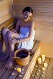 Mujer en sauna Imagen de archivo libre de regalías