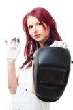 Mujer en soldador sucio del asimiento de los guantes Imagenes de archivo