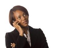Mujer en su teléfono celular Fotografía de archivo libre de regalías