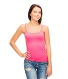 Mujer en top sin mangas rosado en blanco Fotos de archivo libres de regalías