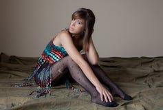 Mujer en top y medias de la franja Imagen de archivo libre de regalías