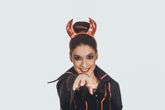 Mujer en traje del carnaval del diablo Imagenes de archivo