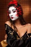 Mujer en traje del este tradicional Foto de archivo libre de regalías