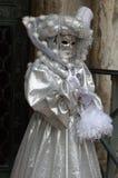 Mujer en traje y máscara Imagenes de archivo