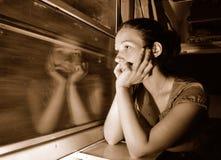 Mujer en tren Fotos de archivo