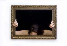 Mujer en un marco de la pintura Foto de archivo libre de regalías