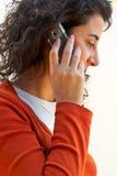 Mujer en un teléfono celular Foto de archivo libre de regalías