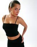Mujer en un vestido negro Imagen de archivo libre de regalías
