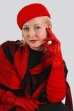 Mujer en una alineada roja Fotos de archivo