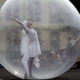 Mujer en una bola transparente Imágenes de archivo libres de regalías