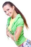 Mujer en una camisa amarilla y una chaqueta verde Imágenes de archivo libres de regalías