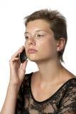 Mujer en vestido con el teléfono móvil Fotografía de archivo