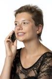 Mujer en vestido con el teléfono móvil Imágenes de archivo libres de regalías
