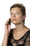 Mujer en vestido con el teléfono móvil Foto de archivo libre de regalías