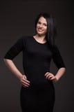 Mujer en vestido negro Imagen de archivo libre de regalías
