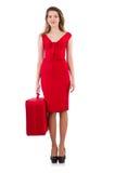 Mujer en vestido rojo y el estuche de viaje aislados Imagen de archivo libre de regalías