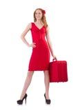 Mujer en vestido rojo y el estuche de viaje aislados Fotografía de archivo