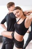 Mujer encantada positiva que disfruta de su clase de danza Fotografía de archivo libre de regalías