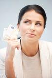 Mujer encantadora con el dinero euro del efectivo Fotografía de archivo libre de regalías