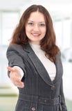 Mujer encantadora con una mano abierta Foto de archivo