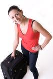 Muchacha turística feliz con su maleta Imagenes de archivo