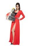 Mujer encantadora que sostiene muchos regalos Feliz Año Nuevo fotos de archivo libres de regalías