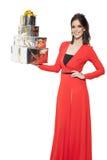 Mujer encantadora que sostiene muchos regalos Feliz Año Nuevo Fotografía de archivo libre de regalías