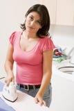 Mujer enfadada para planchar Foto de archivo libre de regalías