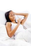 Mujer enferma de la cama Fotografía de archivo