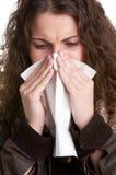 Mujer enferma que estornuda Fotos de archivo libres de regalías