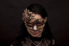 Mujer enmascarada Foto de archivo libre de regalías