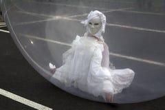 Mujer enmascarada en una esfera Imagen de archivo libre de regalías