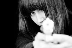 Mujer enojada con el arma Imágenes de archivo libres de regalías