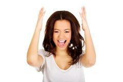 Mujer enojada con las manos para arriba Foto de archivo