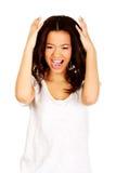 Mujer enojada con las manos para arriba Imagen de archivo libre de regalías