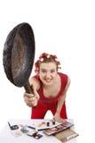 Mujer enojada en rodillos del pelo. Fotografía de archivo libre de regalías